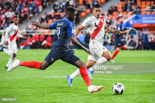 Ousmane Dembele of France and Anderson Santamaria of Peru during the FIFA World Cup match Group C match between France and Peru at Ekaterinburg Arena...