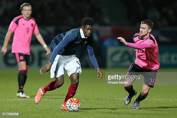 Ousmane Dembele of France and Craig Slater of Scotland during the Uefa U21 European Championship qualifier between France and Scotland at Stade Jean...