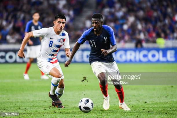 Ousmane Dembele of France and Joe Corona of USA during the International Friendly match between France and United States at Groupama Stadium on June...