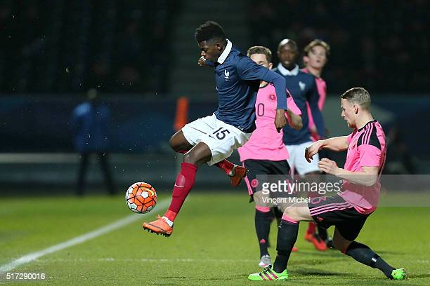 Ousmane Dembele of France and Stephen Kingsley of Scotland during the Uefa U21 European Championship qualifier between France and Scotland at Stade...