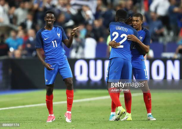 Ousmane Dembele of France celebrates as he scores their third goal with team mates during the International Friendly match between France and England...