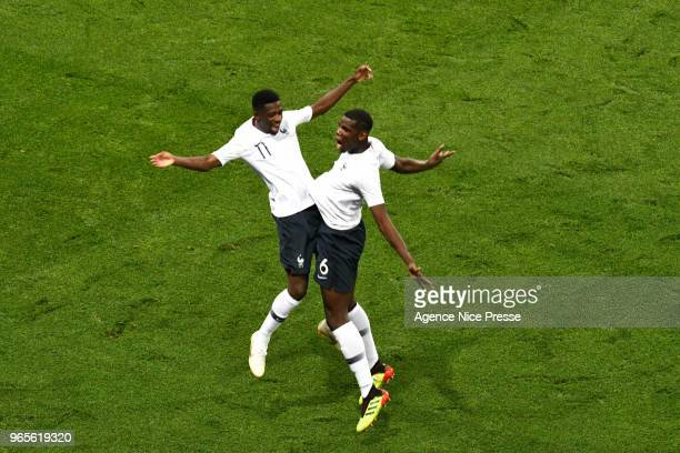 Ousmane Dembele of France celebrates his goal with Paul Pogba during the International Friendly match between France and Italy at Allianz Riviera...