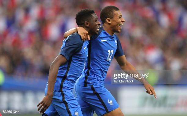 Ousmane Dembele of France celebrates with Kylian Mbappe of France after he scores his team's third goal during the international Friendly match...
