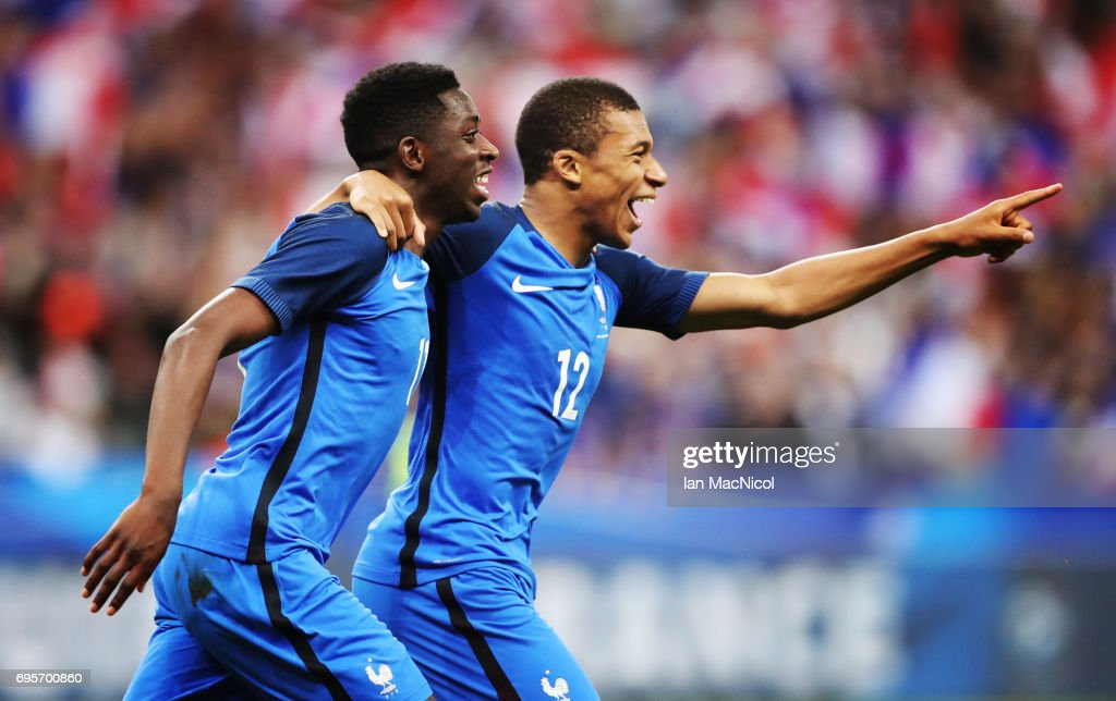 Ousmane Dembele of France celebrates with Kylian Mbappe of France after he scores his team's third goal during the international Friendly match between France and England at Stade de France, on June 13, 2017 in Paris, France.