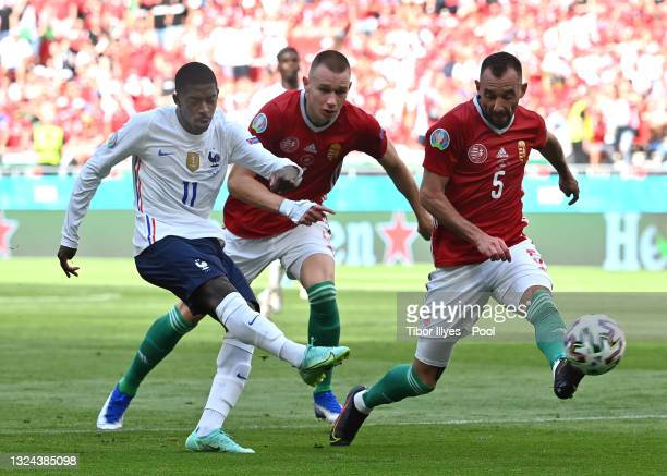 Ousmane Dembele of France hits the post from a shot whilst under pressure from Attila Szalai and Attila Fiola of Hungary during the UEFA Euro 2020...