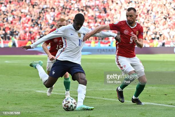 Ousmane Dembele of France looks to cross the ball whilst under pressure from Attila Fiola of Hungary during the UEFA Euro 2020 Championship Group F...