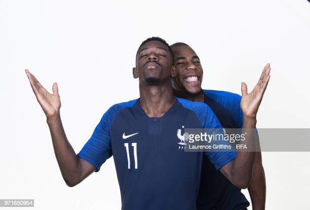 Ousmane Dembele of France poses for a portrait with Djibril Sidibe during the official FIFA World Cup 2018 portrait session at on June 11, 2018 in...