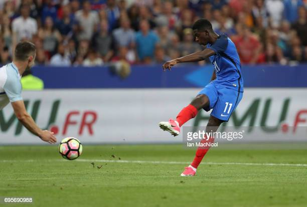 Ousmane Dembele of France scores his team's third goal during the international Friendly match between France and England at Stade de France on June...