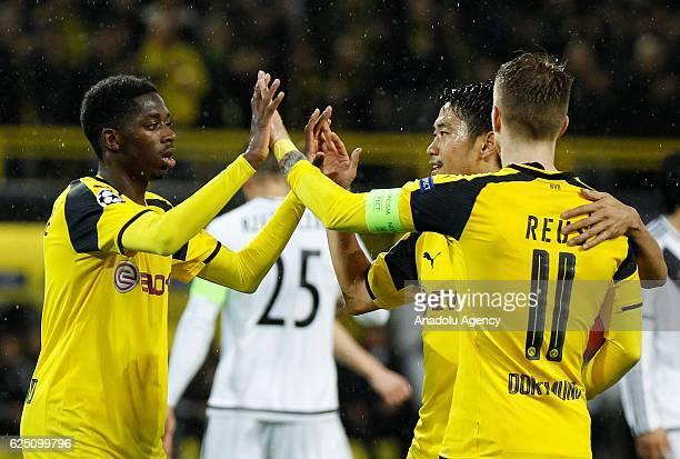 Ousmane Dembele Shinji Kagawa and Marco Reus of Borussia Dortmund celebrate after scoring a goal during the UEFA Champions League group F soccer...