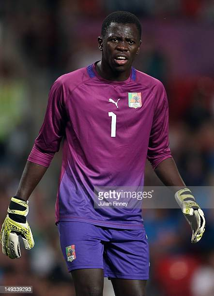 Ousmane Mane of Senegal looks on during the Men's Football first round Group A Match of the London 2012 Olympic Games between Great Britain and...