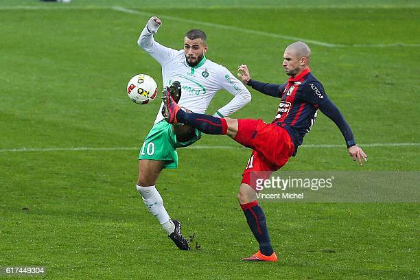 Ousmane Tannane of Sain Etienne and Vincent Bessat of Caen during the Ligue 1 match between SM Caen and AS Saint-Etienne at Stade Michel D'Ornano on...