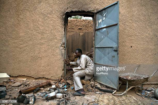 Ousmane Tour������ a Songhai man from Gao tries to salvage what remains of his father��s shop in the market area of Kidal Mali on 24 August 2013 The...