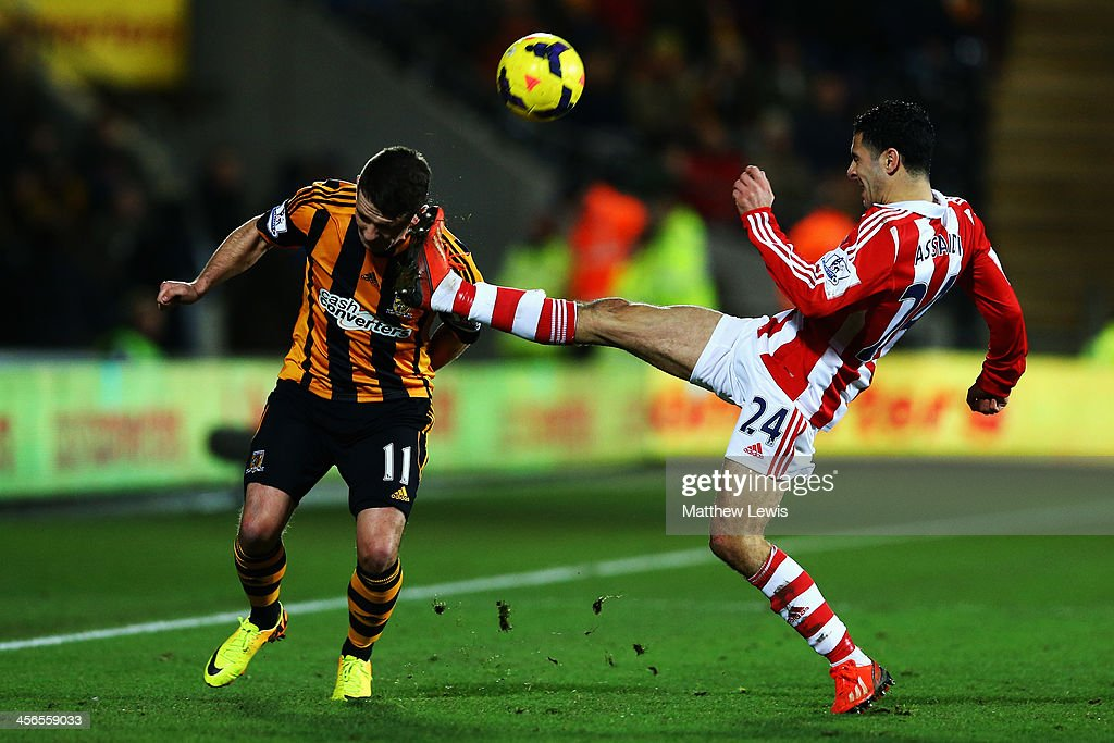 Oussama Assaidi (R) of Stoke City tackles Robbie Brady (L) of Hull City during the Barclays Premier League match between Hull City and Stoke City at KC Stadium on December 14, 2013 in Hull, England.