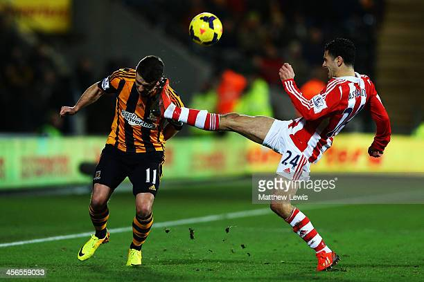 Oussama Assaidi of Stoke City tackles Robbie Brady of Hull City during the Barclays Premier League match between Hull City and Stoke City at KC...