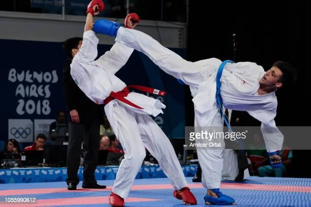 Oussama Edari of Morocco and Alireza Farajikouhikheili of Iran compete in the Men's Kumite 61kg Elimination Round Pool B during day 11 of Buenos...