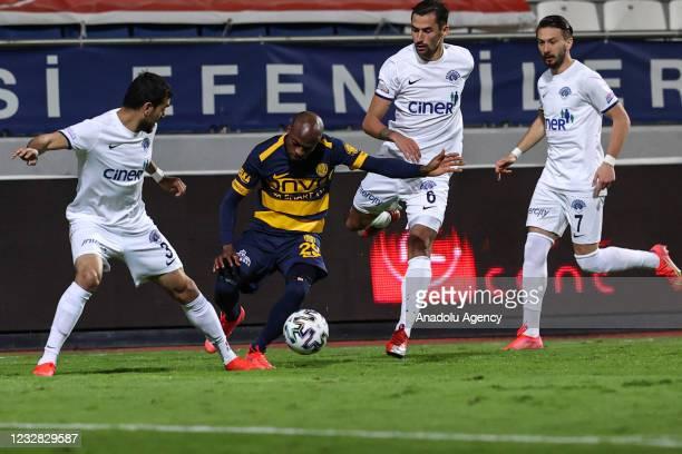 Oussama Hadadi and Loret Sadiku of Kasimpasa in action against Hermenegildo of MKE Ankaragucu during the Turkish Super Lig week 41 match between...