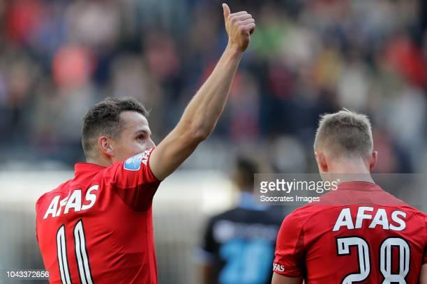 Oussama Idrissi of AZ Alkmaar celebrates 10 with Albert Gudmundsson of AZ Alkmaar during the Dutch Eredivisie match between AZ Alkmaar v PEC Zwolle...
