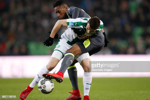 Oussama Idrissi of FC Groningen Joshua Brenet of PSV during the Dutch Eredivisie match between FC Groningen v PSV at the NoordLease Stadium on...