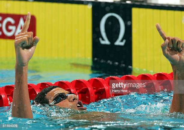 Oussama Mellouli of Tunisia celebrates his gold in the Men's 400 Individual Medley during the FINA World Swimming Championships on October 8, 2004 at...
