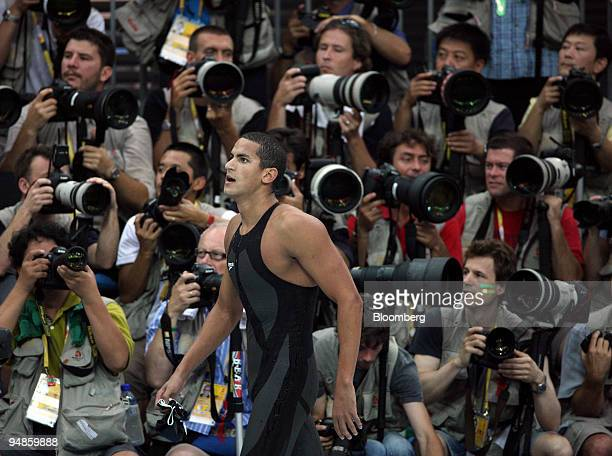 Oussama Mellouli of Tunisia walks past photographers after the men's 1500meter freestyle swimming event on day nine of the 2008 Beijing Olympics in...