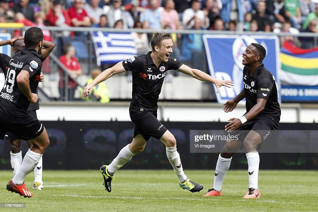 Oussama Tannane (L), Mike te Wierik of Heracles Almelo (C), Milano Koenders of Heracles Almelo (R) during the Dutch Eredivisie match between sc Heerenveen and Heracles Almelo on August 18, 2013 at the Abe Lenstra stadium in Heerenveen, The Netherlands.