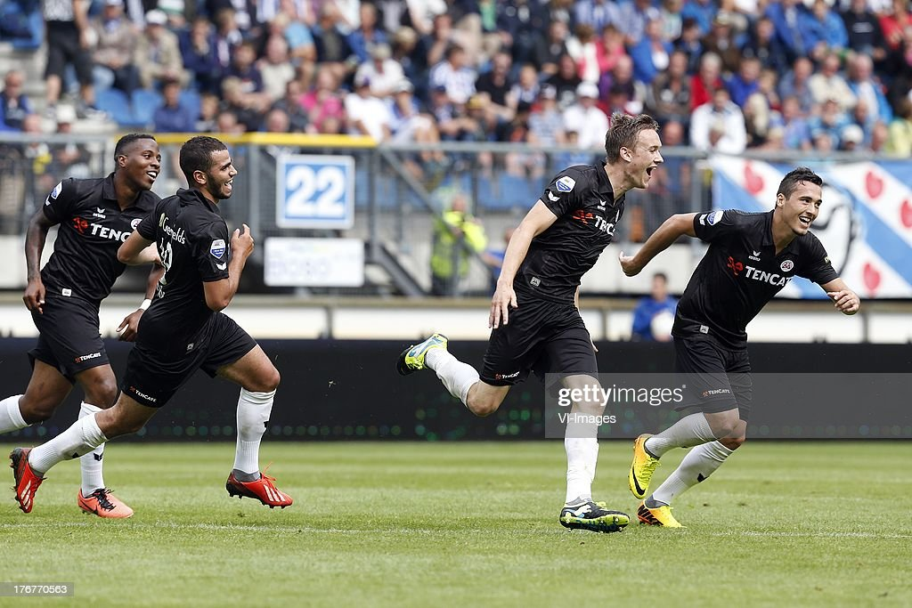 Oussama Tannane (2L), Mike te Wierik of Heracles Almelo (2R), Milano Koenders of Heracles Almelo (L) during the Dutch Eredivisie match between sc Heerenveen and Heracles Almelo on August 18, 2013 at the Abe Lenstra stadium in Heerenveen, The Netherlands.