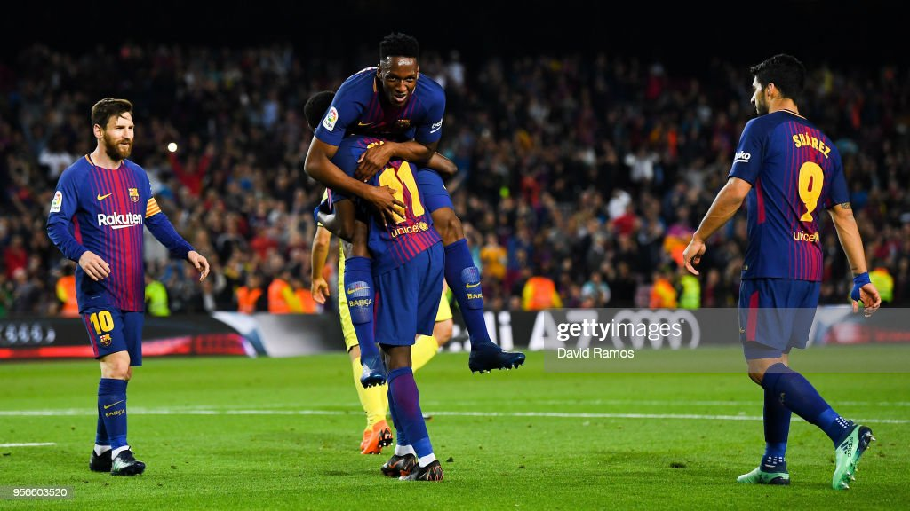 Oussame Dembele of FC Barcelona celebrates with his team mates Yerry Minam Lionel Messi and Luis Suarez after scoring his team's fifth goal during the La Liga match between FC Barcelona and Villarreal at Camp Nou on May 9, 2018 in Barcelona, Spain.