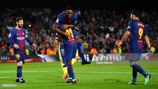 Oussame Dembele of FC Barcelona celebrates with his team mates Yerry Minam Lionel Messi and Luis Suarez after scoring his team's fifth goal during...