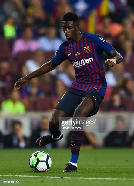 Oussame Dembele of FC Barcelona runs with the ball during the La Liga match between Barcelona and Real Sociedad at Camp Nou on May 20 2018 in...