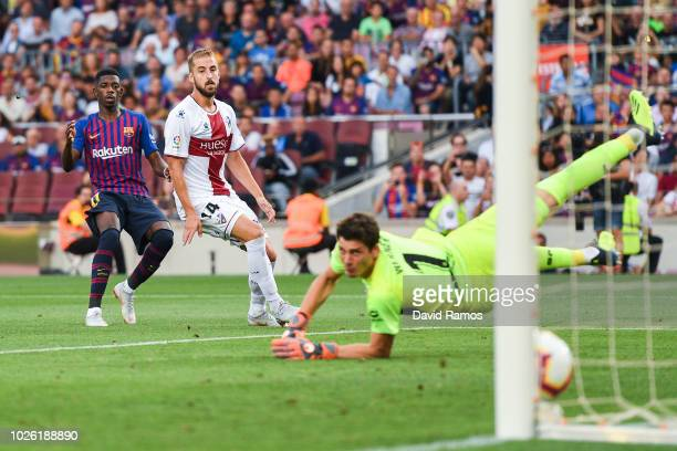Oussame Dembele of FC Barcelona scores his team's fourth goal during the La Liga match between FC Barcelona and SD Huesca at Camp Nou on September 2...