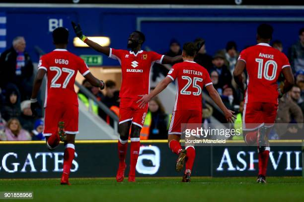 Ousseynou Cisse of MK Dons celebrates scoring his sides first goal during The Emirates FA Cup Third Round match between Queens Park Rangers and...