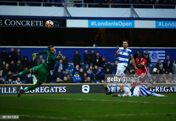 Ousseynou Cisse of MK Dons scores his sides first goal during The Emirates FA Cup Third Round match between Queens Park Rangers and Milton Keynes...
