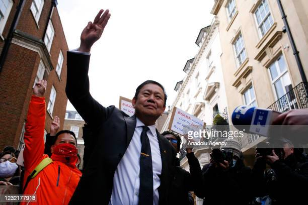 Ousted ambassador of Myanmar to the UK Kyaw Zwar Minn holds up a three-finger salute outside the Embassy of Myanmar in London, United Kingdom on...
