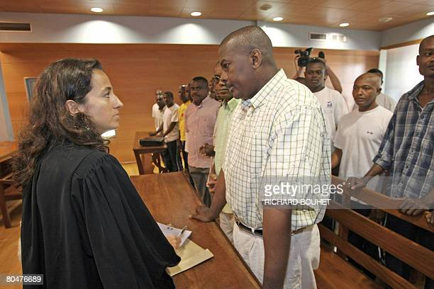 Ousted Anjouan leader Mohamed Bacar listens to his lawyer Marie Briot next to some of his supporters on April 2 2008 at the administrative court of...