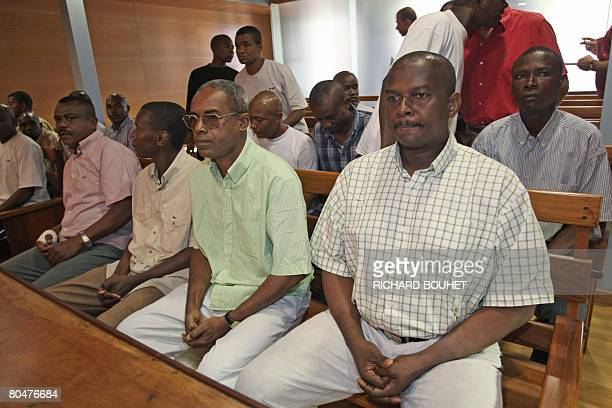Ousted Anjouan leader Mohamed Bacar sits next to some of his supporters on April 2 2008 at the administrative court of SaintDenisdelaRunion on the...