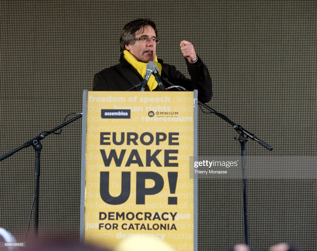 Ousted Catalan leader Carles Puigdemont deliver a speeche during a pro-Catalan supporters during a demonstration in the EU quarter. Thousands of Catalonian people protest for the Independence of Catalonia.