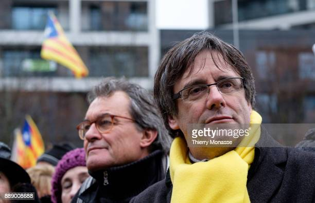 Ousted Catalan leader Carles Puigdemont listens to speeches during a proCatalan supporters during a demonstration in the EU quarter Thousands of...