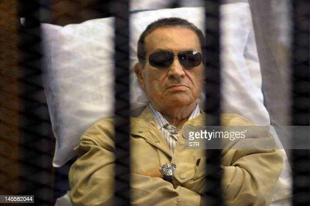 Ousted Egyptian president Hosni Mubarak sits inside a cage in a courtroom during his verdict hearing in Cairo on June 2, 2012. A judge sentenced...