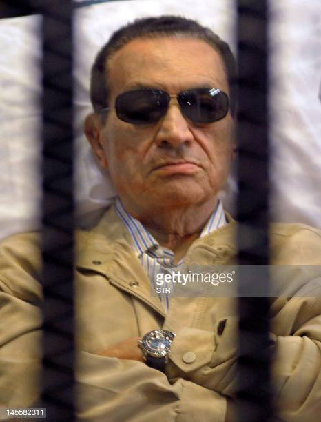 Ousted Egyptian president Hosni Mubarak sits inside a cage in a courtroom during his verdict hearing in Cairo on June 2 2012 A judge sentenced...