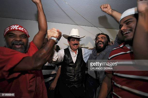Ousted Honduran President Manuel Zelaya and supporters celebrate their national football team's victory and subsequent qualification to the FIFA...