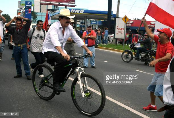 Ousted Honduran President Manuel Zelaya arrives in his bike to take part in a march of presidential candidate for the Opposition Alliance Against the...