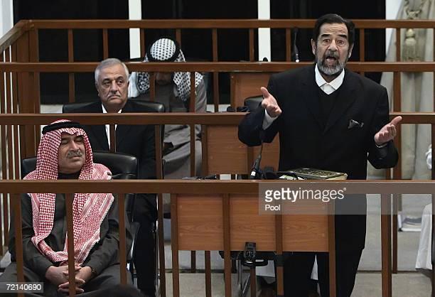 Ousted Iraqi leader Saddam Hussein gestures as Sultan Hashim Ahmad alJaburi alTai Sabir Aba alAziz and Ali Hasan alMajid look on during their trial...