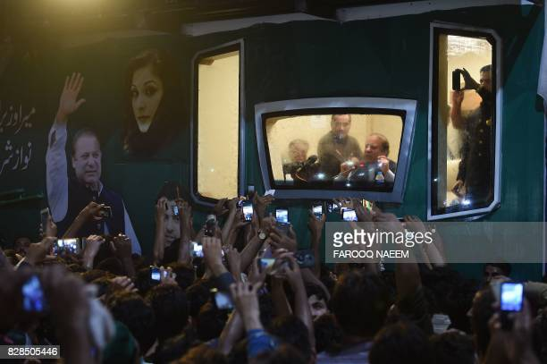 TOPSHOT Ousted Pakistani prime minister Nawaz Sharif addresses a rally from his bulletproof container in Rawalpindi on August 9 2017 Deposed...