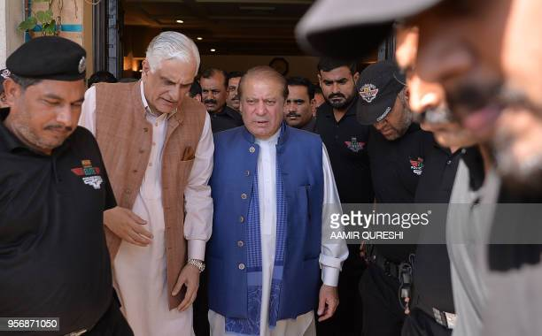 Ousted Pakistani prime minister Nawaz Sharif speaks with former law minister Zahid Hamid as he leaves after addressing a press conference in...