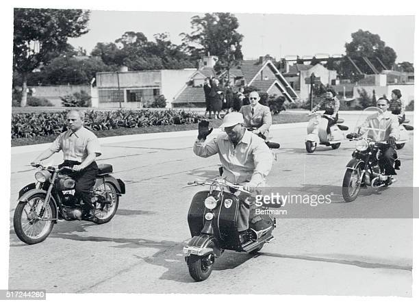 Ousted President Juan D Peron is shown leading a motor scooter parade of members of the Secondary School Union through Buenos Aires Close behind are...