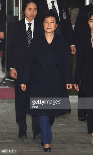 Ousted South Korean President Park Geun-hye, leaves after hearing on a prosecutors' request for her arrest for corruption at the Seoul Central...