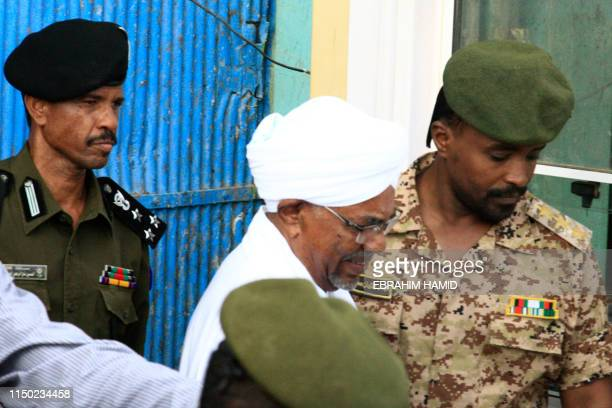 TOPSHOT Ousted Sudanese leader Omar alBashir is escorted before being driven in an armed convoy from the Kober prison to the prosecutor's office in...