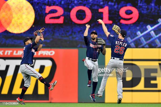Out fielders Eddie Rosario Byron Buxton and Max Kepler of the Minnesota Twins celebrate after defeating the Cleveland Indians at Progressive Field on...