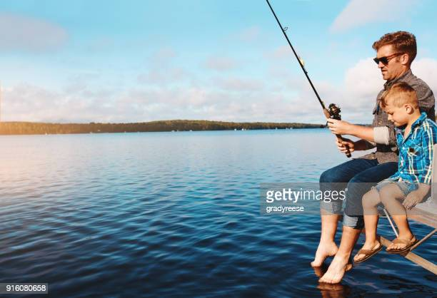 out for a catch - fishing stock pictures, royalty-free photos & images
