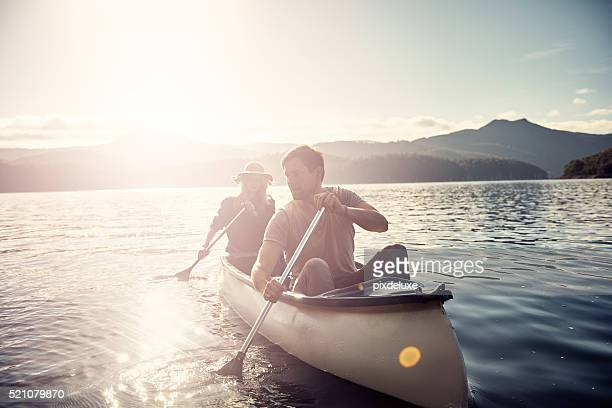 out for a leisurely boat ride - canoe stock pictures, royalty-free photos & images